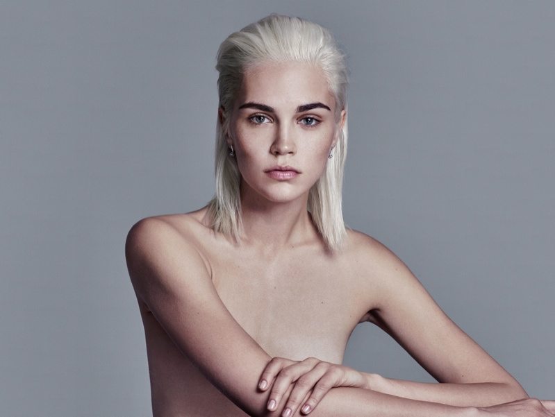 Model wears a slicked-back hairstyle