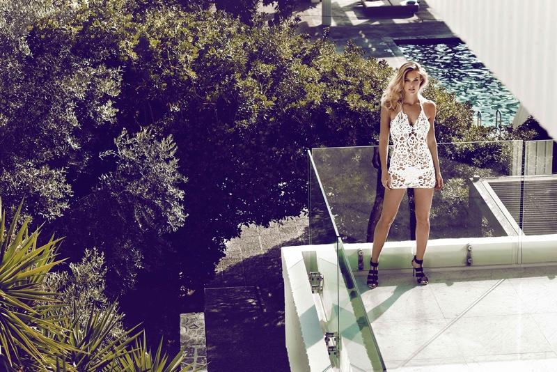 Bar Refaeli stuns in white beach cover-up with matching bikini underneath