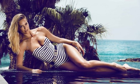 Bar flaunts her legs in a striped, strapless one-piece swimsuit