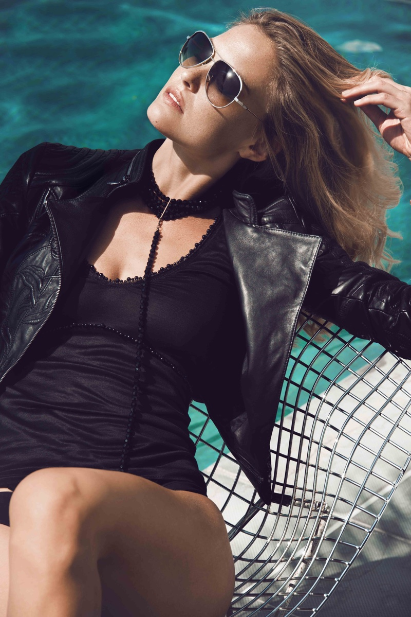 Bar soaks up the hot sun in a black swimsuit and cropped leather jacket