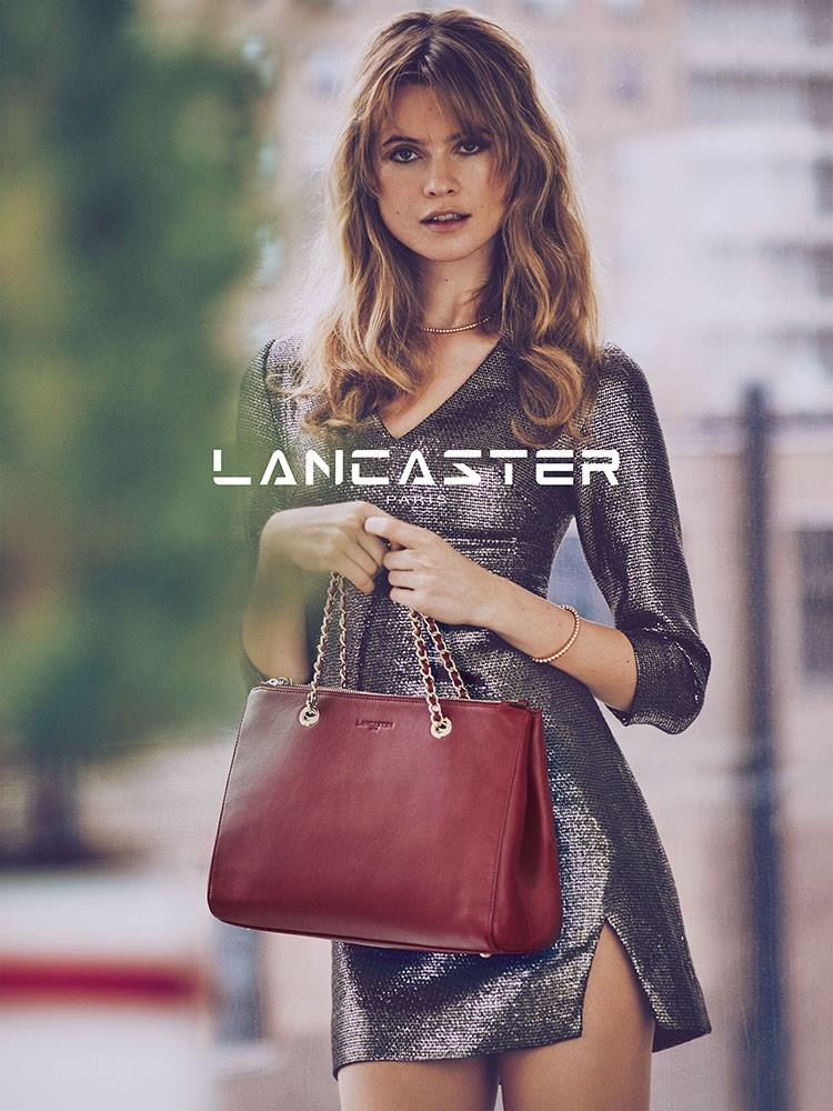 Christmas holiday dress - Behati Poses In A Leopard Print Jacket And Brown Tote From Lancaster