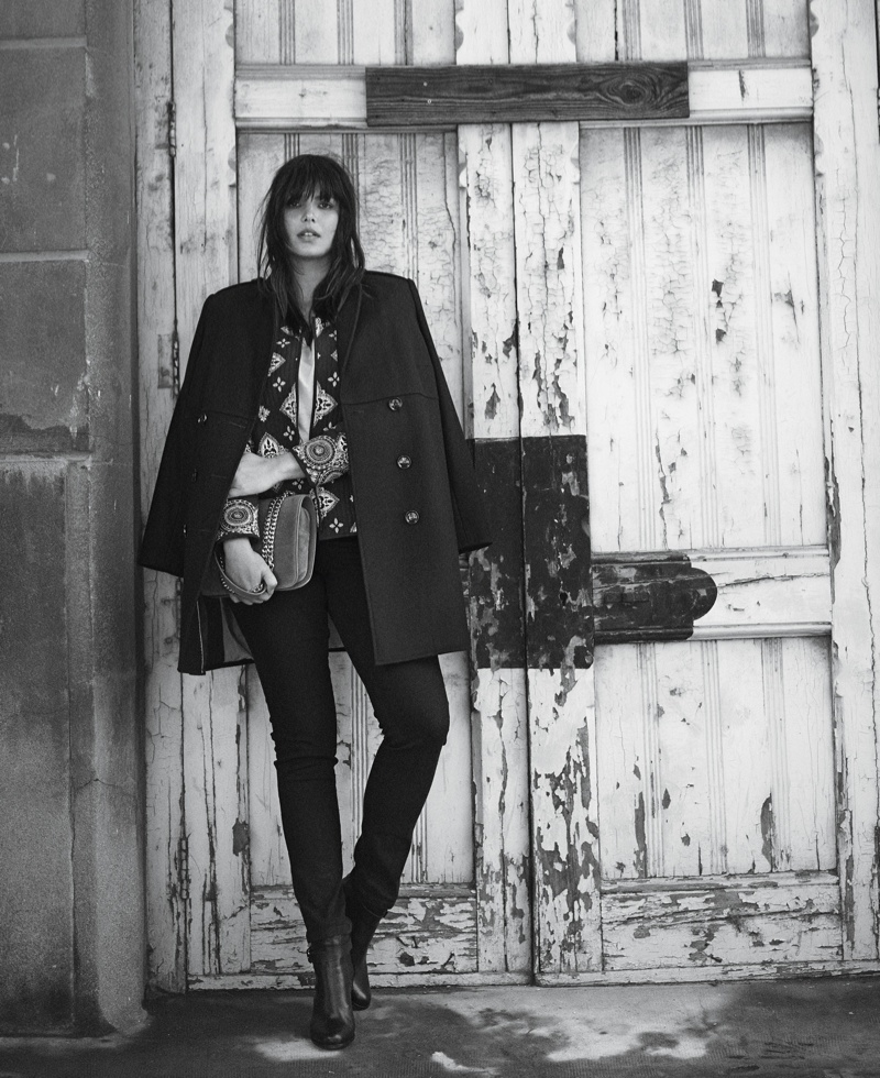 Candice Huffine models a draped jacket with a print blouse and jeans