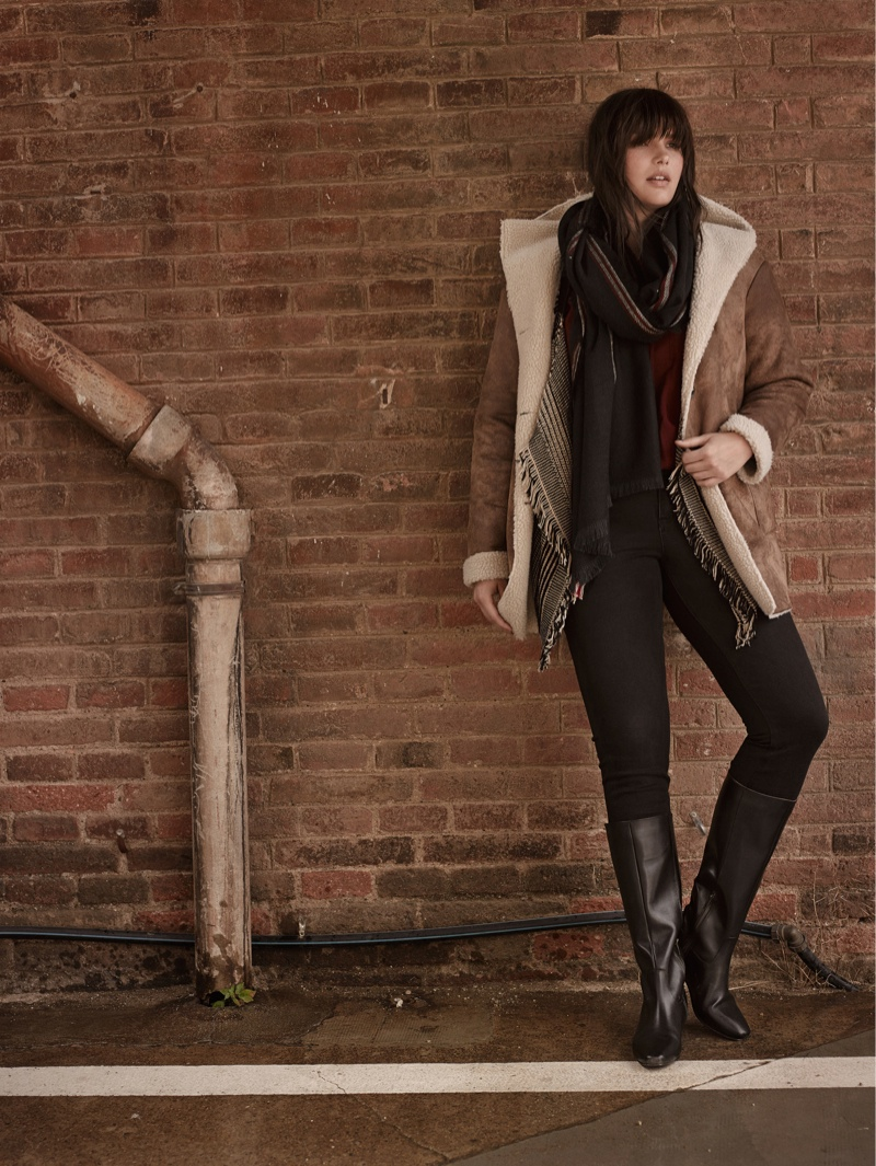 Candice Huffine models faux shearling coat from Violeta by Mango