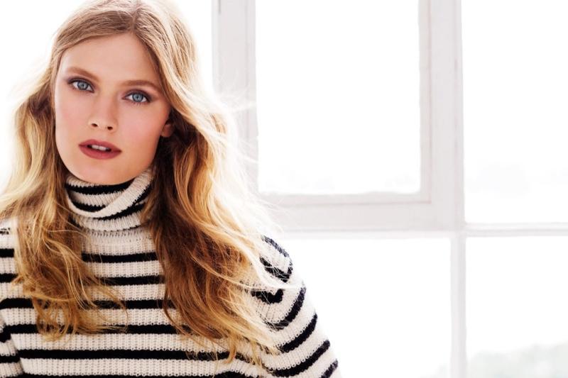 Constance models a striped turtleneck