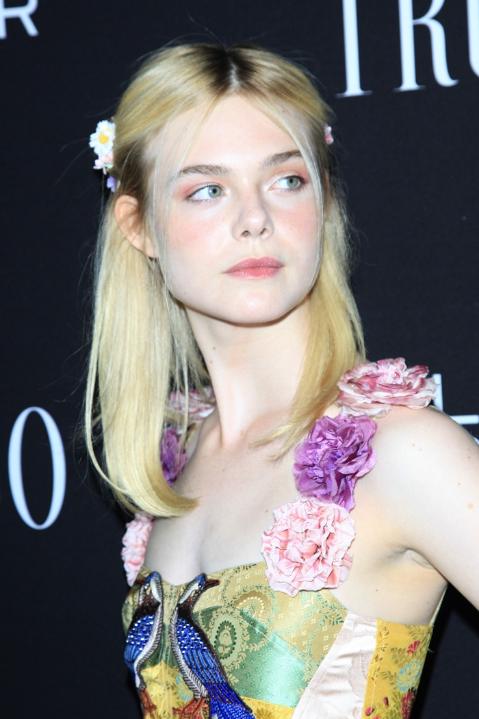 Elle Fanning wears flowers in her hair to go along with her floral Gucci dress. Photo: Shutterstock.com / Helga Esteb