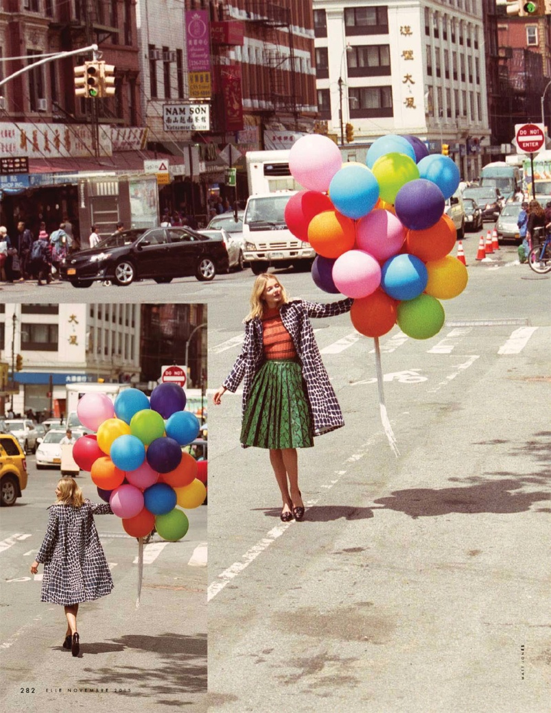 Eniko Mihalik poses with balloons in the November issue of ELLE Italia