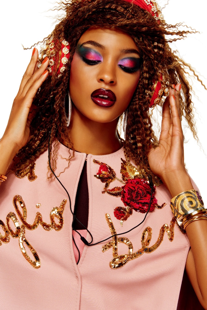 Jourdan poses in Dolce & Gabbana dress and headphones