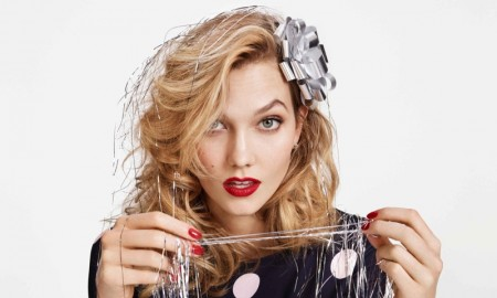 Karlie looks party ready with a bow and silver streamers
