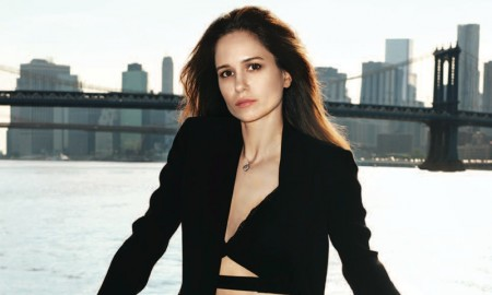 Katherine poses in Versace jacket, top and pants with Fred Leighton necklace