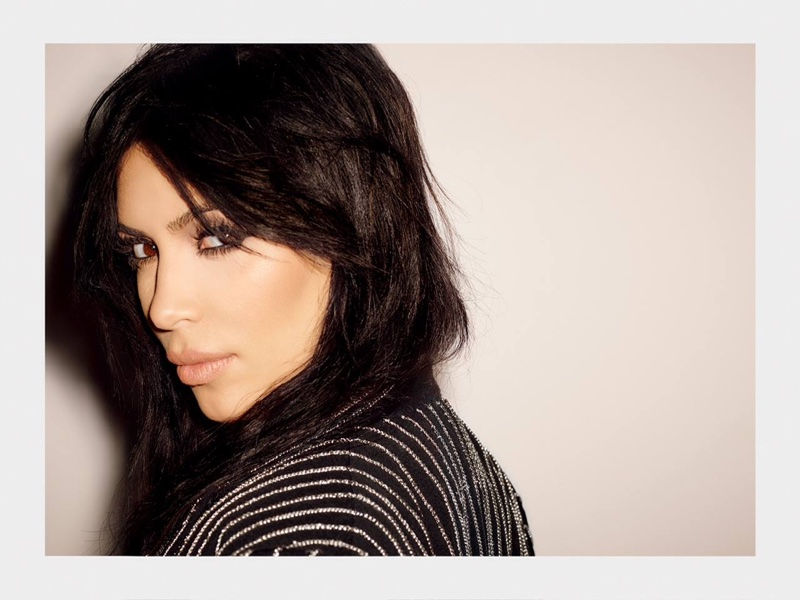Kim wears her hair in rock and roll glam waves