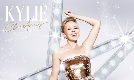 Kylie Minogue glitters in a gold dress on her album cover for 'Kylie Christmas'. Out on November 7, the new release features timeless classics as well as duets with Iggy Pop and James Corden.
