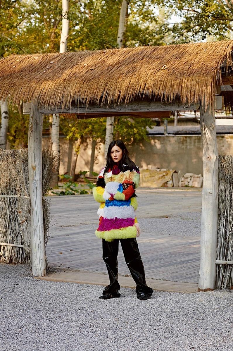 Liu Wen poses in multi-colored fur coat