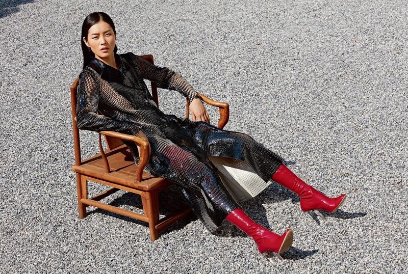 Liu models a black, lacquered leather Dior coat