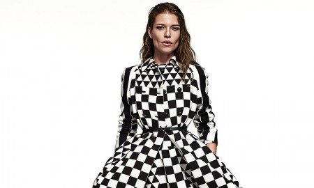 Louise poses in striped and checkered dress from Valentino