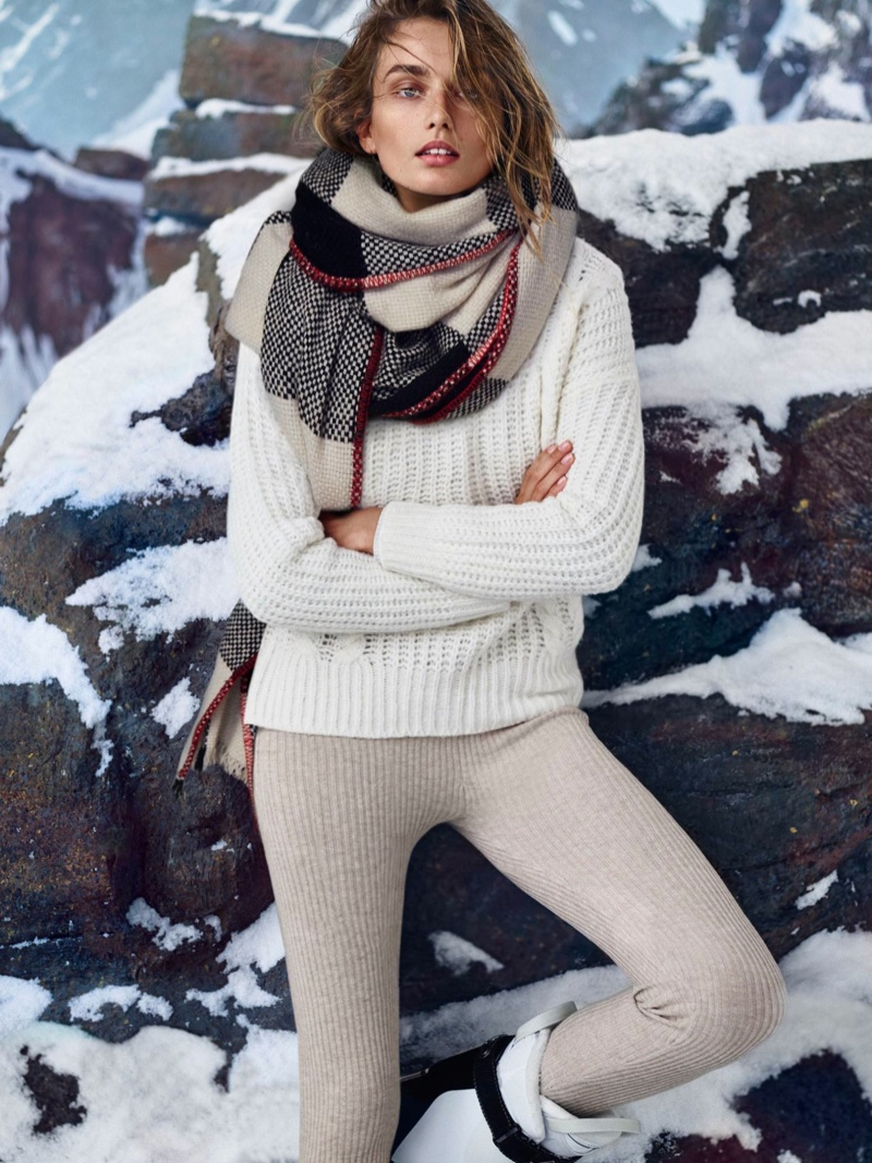 Andreea wears scarf, sweater and pants from Massimo Dutti