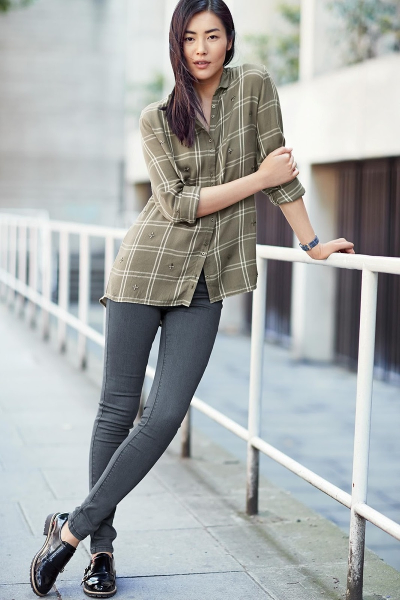 Liu Wen poses in a windowpane print shirt with slim-fit jeans