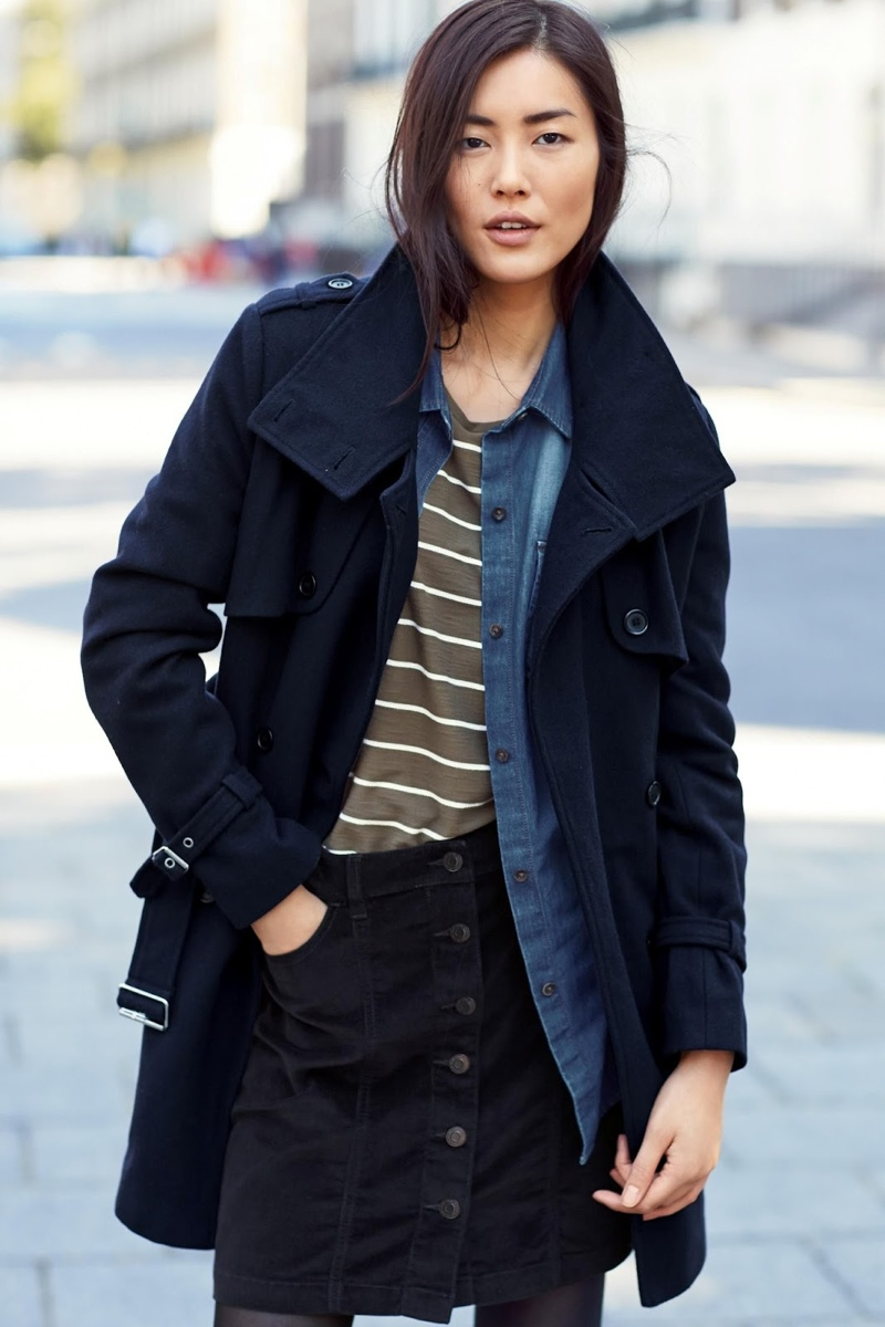 Next showcases a layered look with a open jacket, striped shirt and denim top