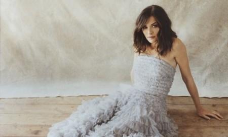 Rachel Weisz poses in Alexander McQueen gown