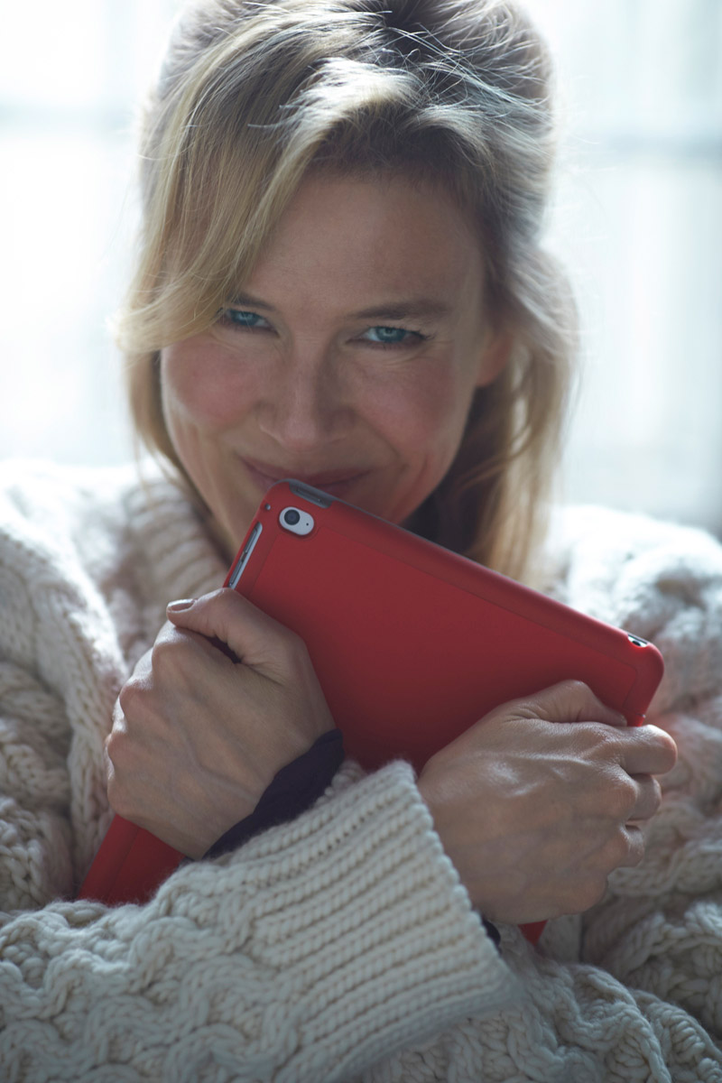 Renee Zellweger is back for 'Bridget Jones's Baby' which is the third installment in the Bridget Jones series. Working Title has released an image of Renee in character while clutching to an iPad. Photo: Working Title Films