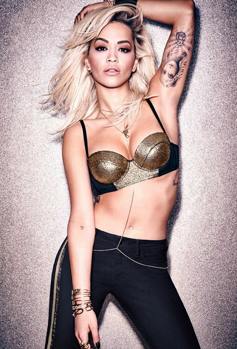 Rita wears her hair in tousled and sexy tresses for the shoot