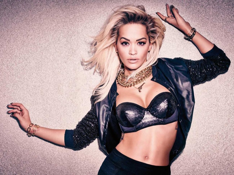 Rita Ora poses in a bustier top and cropped jacket