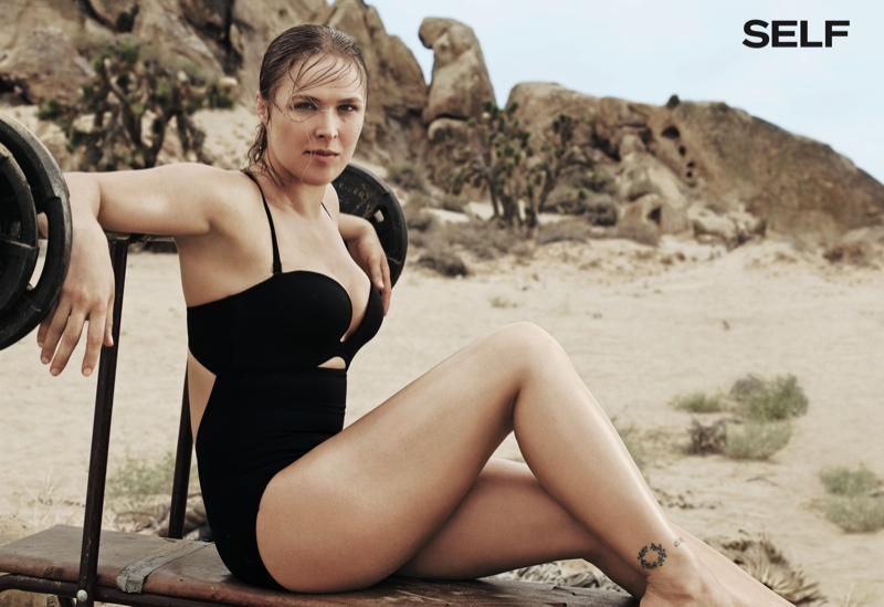 Ronda shows off her athletic figure in a black swimsuit