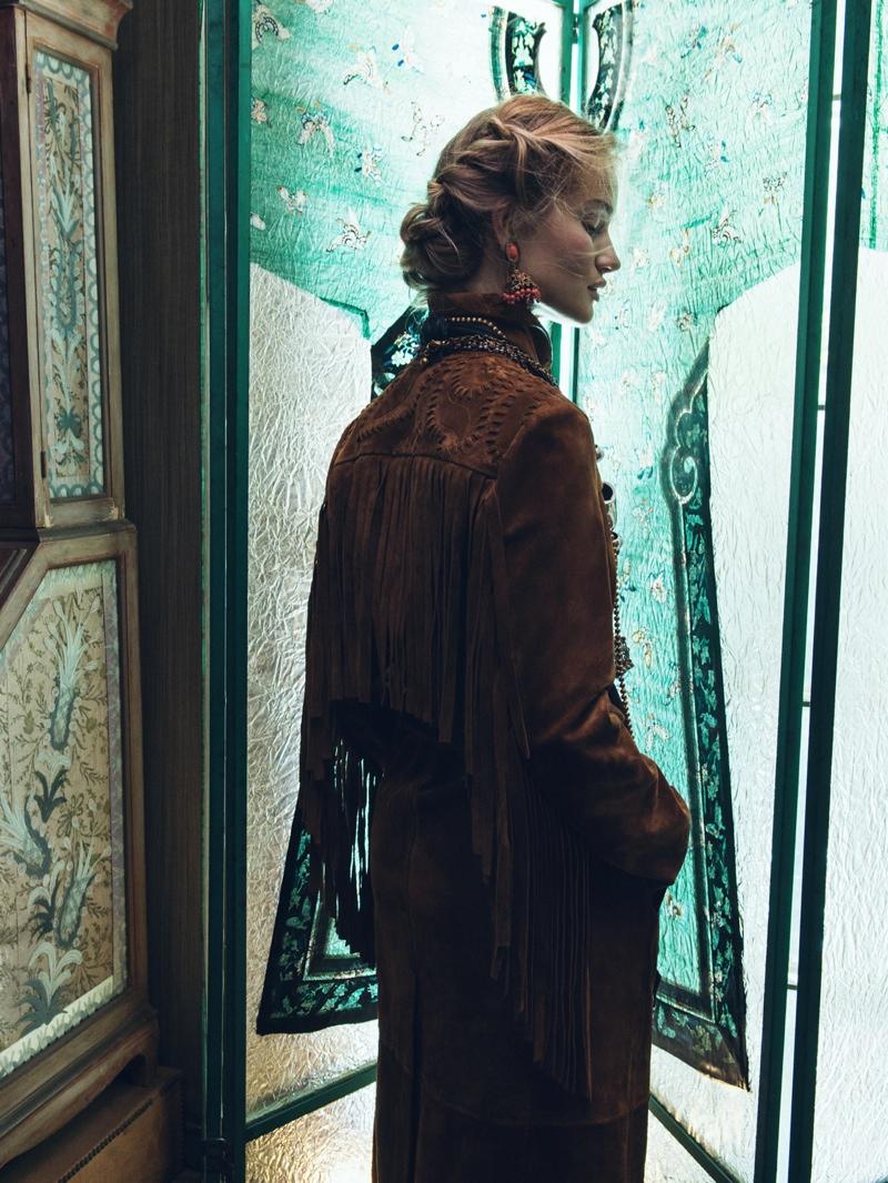 Rosie models fringe embellished jacket designed by Burberry