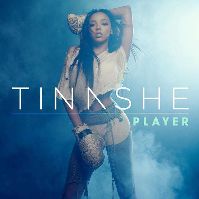 R&B singer Tinashe flaunts her midriff in a sporty look for the single cover artwork of her new song, 'Player'. The single is out now worldwide.