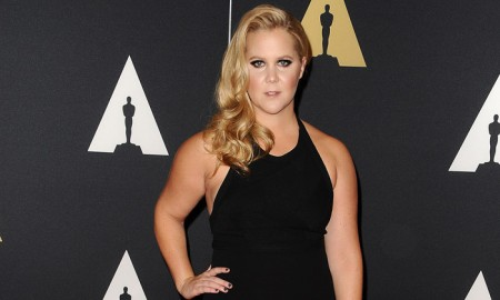 Amy Schumer attends the 7th annual Governors Awards while wearing a black Calvin Klein Collection gown. © 2015 Jason LaVeris/FilmMagic