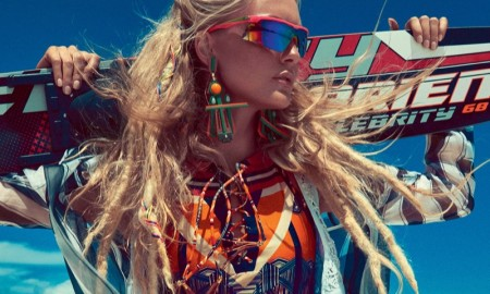 The model wears colorful beach fashion in the editorial