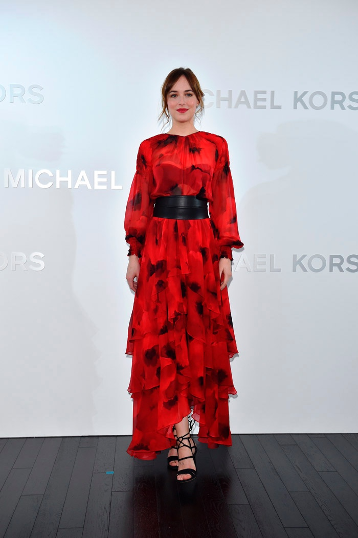 Dakota Johnson at Michael Kors Ginza store opening in Japan wearing red poppy print dress
