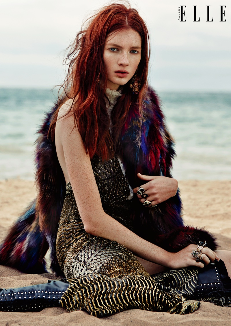 The model wears bohemian inspired looks on the beach for ELLE Canada