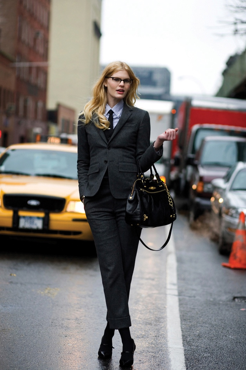 Charcoal wool pantsuit with shrunken fit, button-down collar shirt and black necktie; photographed on 36th Street, New York. Photo by Scott Schuman, The Sartorialist.