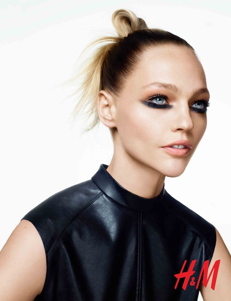 H&M shows that smudged eye makeup and a messy top knot can make quite the statement