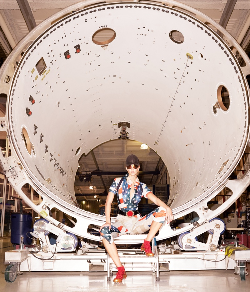 Karlie poses in Elon Musk's SpaceX headquarters for the shoot