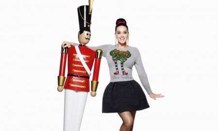 The pop star poses with a nut cracker figurine
