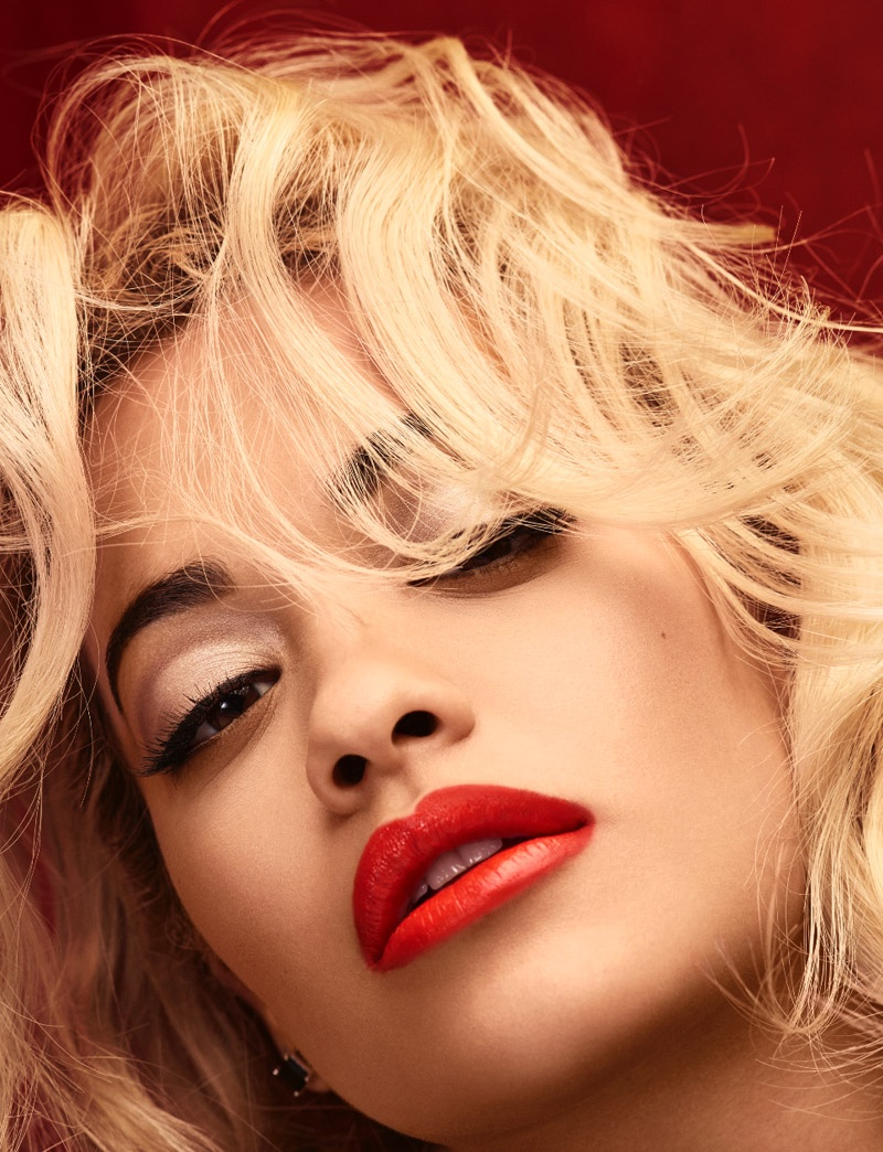 The singer shows off a glossy red lip for the images