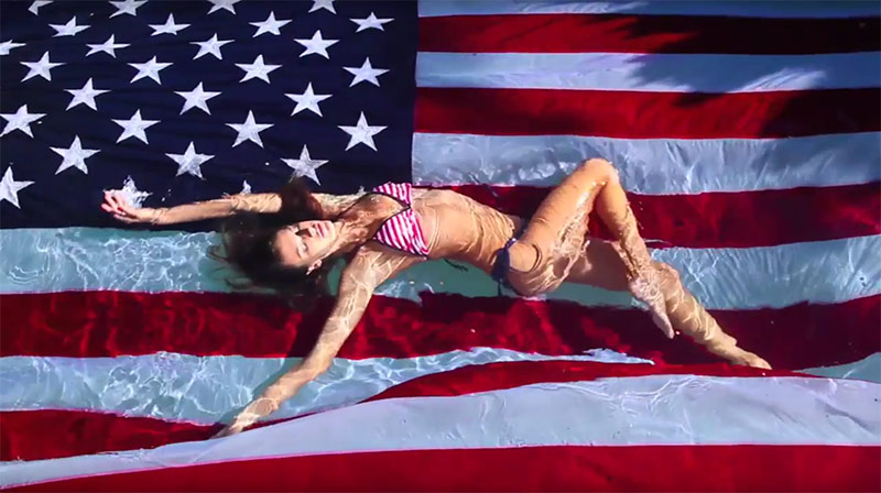 Alessandra Ambrosio poses with the American flag in a stars and stripes bikini for LOVE's advent calendar
