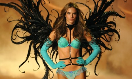 Clad in a turquoise blue lingerie look, Alessandra Ambrosio looked undeniably hot with a black pair of wings at the 2013 Victoria's Secret Fashion Show. Photo: FashionStock.com / Shutterstock.com