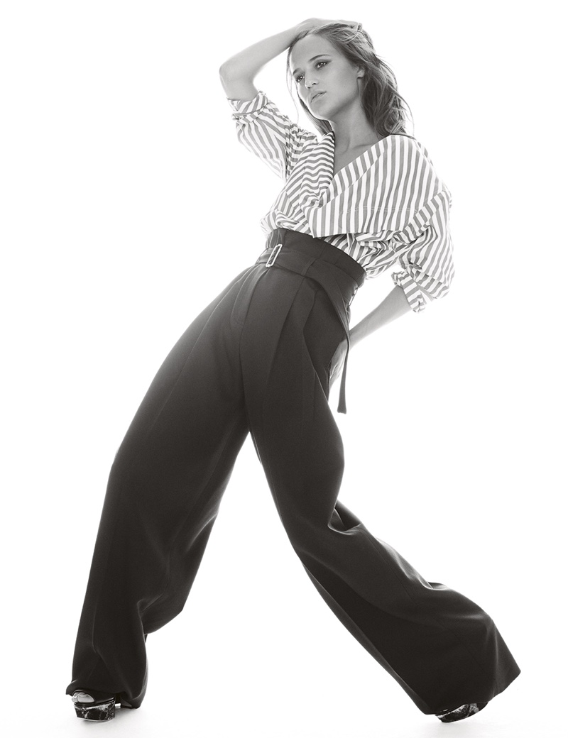 Alicia wears Celine striped shirt and pants