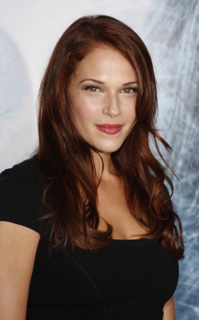 The Mentalist actress Amanda Righetti shows off a dark auburn hair color on the red carpet. The hue strikes the perfect balance between brown and red tones.