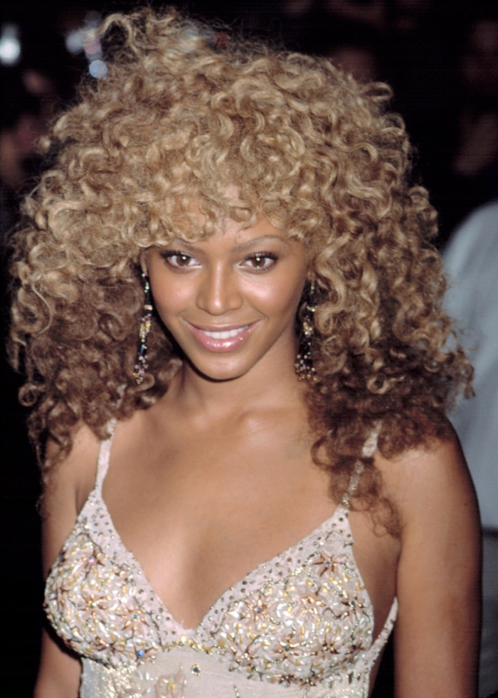 In 2002, before she became a megastar we know today, Beyonce wore a curly blonde hairstyle at the Goldmember premiere in New York. Photo: Everett Collection / Shutterstock.com