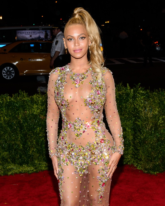 At the 2015 Met Gala, Beyonce slayed the red carpet in a naked dress and  blonde, high side ponytail. Photo: Eastfjord Productions / Shutterstock.com
