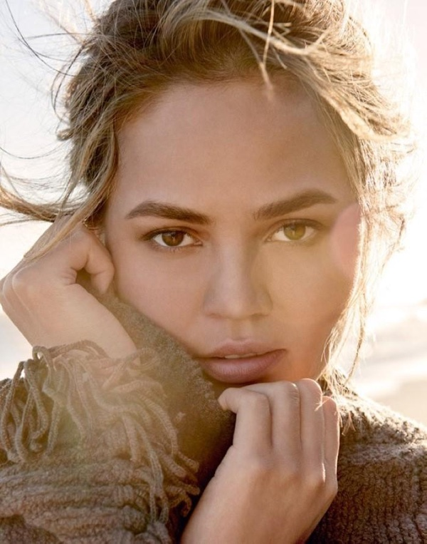 Chrissy Teigen wears a comfortable looking sweater in this closeup shot