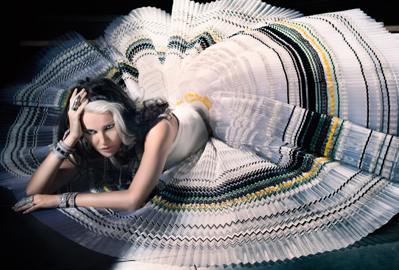 Daphne Guinness poses on the floor while wearing ball gown