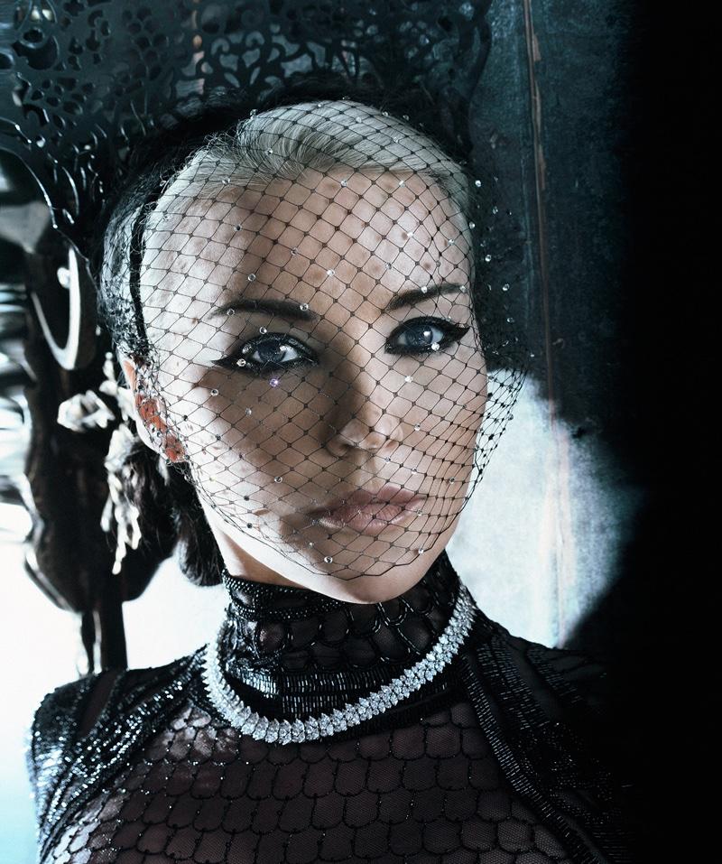 Daphne stuns in a closeup shot where she models a mesh mask