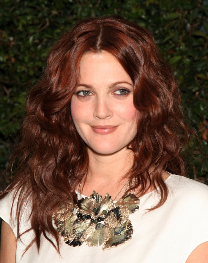 Drew Barrymore never shies away from changing her hair color, but she also looks amazing with a dark auburn shade. Photo: DFree / Shutterstock.com