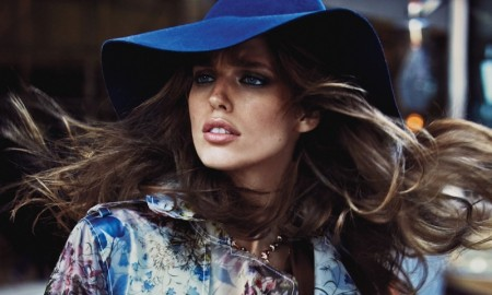 The model embraces 70s style in the colorful fashion editorial