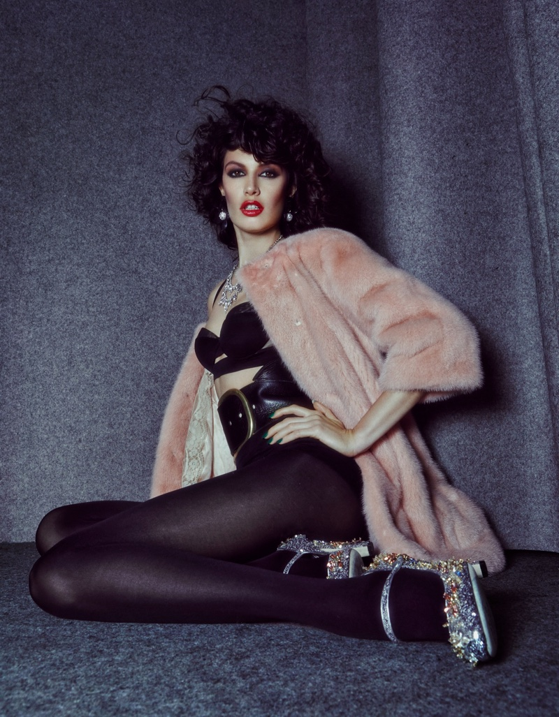 The model wears fur and lingerie looks in the fashion editorial