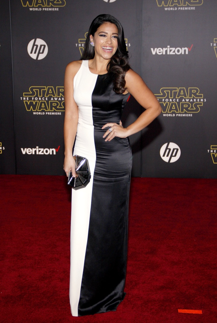 Gina Rodriguez rocks white and black gown. Photo: Tinseltown / Shutterstock.com